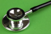 Stethoscope close-up on green background
